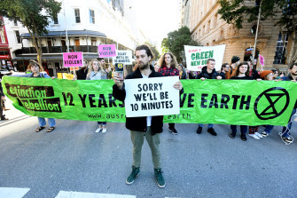 Extinction Rebellion protesters blocking traffic in Brisbane.