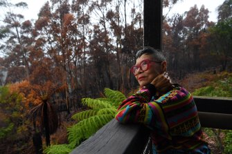 Artist and fashion designer Jenny Kee is thrilled to see regrowth of native plants in the backyard after it was ravaged by bushfire.