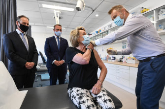Health Minister Greg Hunt, Tim Wilson MP, Dale Austin (patient) and Dr Nick Kokotis at the Bluff Road Medical Centre in March.