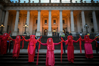 Extinction Rebellion protesters outside Parliament House in Melbourne on Monday.