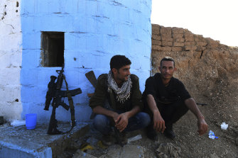 YPG militiamen Maslum Hassakeh and Zenar Zenar rest at a checkpoint 10 kilometres from the front line.