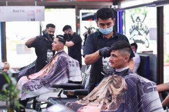 Barber Mohammad Najafi at his hair salon, Najafi Barber, in Dandenong.