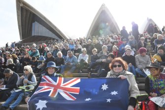 Margaret Cheah, left, and Judy Scott with their flag at the Opera House for Bob Hawke's memorial service.