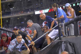 Fans rush to evacuate after hearing gunfire, during a baseball game between the San Diego Padres and the Washington Nationals at Nationals Park in Washington on Saturday July 17, 2021. The game was suspended in the sixth inning after police said there was a shooting outside the stadium.