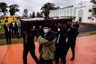 Pallbearers carry Ayaz Younus's coffin at his funeral.