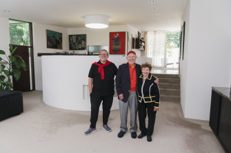 Henry Weinreich with his parents Joseph and Aneta Weinreich inside their Seidler-designed home.