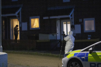 Witnesses said the gunman kicked in the door of the house before shooting the residents.