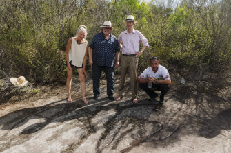 The Cromer Heights rock carvings were declared protected on Thursday. From left: Conny Harris, Aboriginal Affairs Minister Don Harwin, Anthony Harris and land council CEO Nathan Moran.