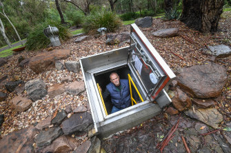 Drew Gordon in his fire bunker in North Warrandyte on Melbourne's forested fringe. Different rules apply in different states for such shelters.