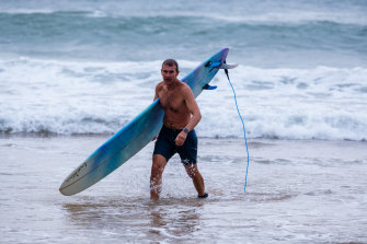 Rob Stokes emerges from the surf on the northern beaches