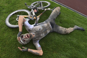 Sonny Colbrelli sobs after winning the rain-soaked 118th edition of Paris-Roubaix in northern France.
