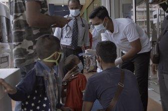 Rohingya refugees are screened for coronavirus at a local clinic facility in Kuala Lumpur, Malaysia.