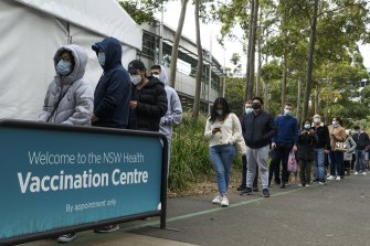 Long lines outside the COVID-19 vaccination centre at Olympic Park on Saturday.