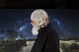 Artist Michael Glasheen with one of his works, Emu In The Milky Way.
