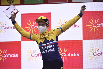 Primoz Roglic celebrates on the podium after winning a stage earlier in the Vuelta.