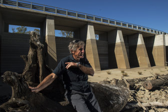 David McConnell, chairman of the Koondrook-Perricoota Alliance and a local farmer, sits in front of one of the gates of the massive 'environmental water management' project.