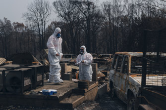 Contractors test a property in Conjola Park for traces of asbestos a week after the fires.