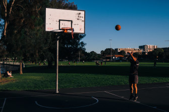 Friends took turn playing basketball in groups of two at Tasker Park in Canterbury.
