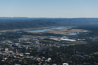 An aerial photograph of Greater Western Sydney taking in Penrith, Cranebrook and the Nepean River  with the Blue Mountains rising in the background.