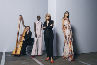 Carla Zampatti, with models Amer Athiu, Roberta Pecoraro and harpist Hannah Lane from the Australian Brandenburg Orchestra, which performed during Carla's show at Mercedes-Benz Fashion Week Australia, Carriageworks, Everleigh. May 2019.