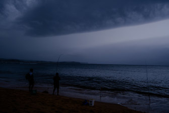 Fisherman at Fisherman's Beach north of Long Reef, before today's thunderstorm.