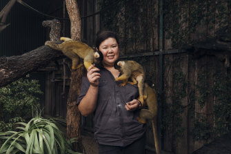 "Zoo keeper Rachel Yeo with squirrel monkeys. ""It felt like something out of a nightmare,"" she says of her experience fighting the fire."