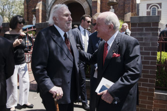 John Laws and Alan Jones catch up at Friday's funeral for John Fordham.