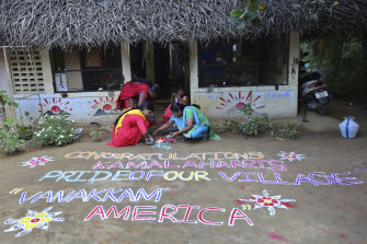 Women in the Indian village of Thulasendrapuram  the home town of Kamala Harris's maternal grandfather   prepare a Kolam, a traditional art work using coloured powder, to congratulate the new US Vice-President-elect.