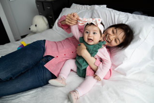 Audrey Ku and her eight-month-old daughter, Madeleine, who was conceived using IVF.