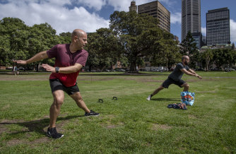 Tony Gonzalez and Brendan Crozier train - at the required social distance - at The Domain after their gym shut down.