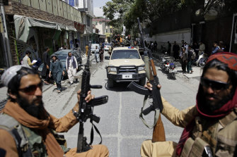 Taliban fighters patrol the streets of Kabul after their takeover.