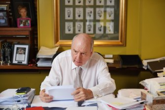 Alan Jones at his desk, where he looks through email correspondence and research.