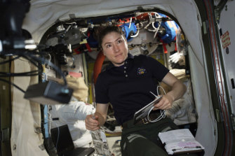 Astronaut and Expedition 59 Flight Engineer Christina Koch works on US spacesuits inside the International Space Station.