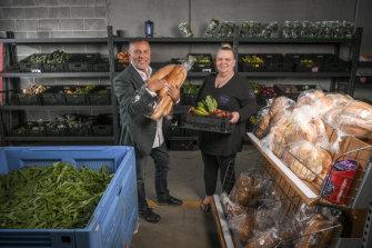 Doing good: Benefactor Joe Calleja with Bk 2 Basics Melbourne founder Kelly Warren at the Narre Warren warehouse.