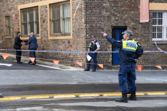 Police at the crime scene outside Essenza Italian restaurant in Surry Hills.