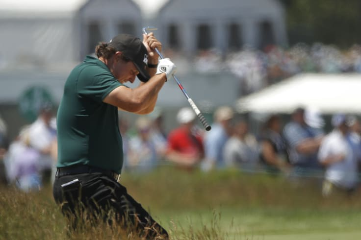 Course management: Phil Mickelson  blows up after a shot from the fescue  during the third round of the US Open..