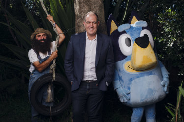 """""""We upset all sides of politics, simply by holding people to account,"""" says ABC boss David Anderson, here with Gardening Australia host Costa Georgiadis and Bluey."""