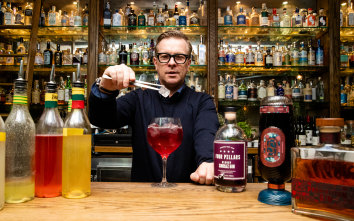 """The Barber Shop in Sydney. Barber Shop bar owner Mikey Enright making a cocktail with a grape-based gin, a gintonica...Story on the increasing number on Australian grape-based gins on the market, such as Four Pillars Bloody Shiraz gin and Never Never's new """"Ginache""""."""