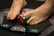 It's a cinch for them: a competitor in the 3x3x3 With Feet category.