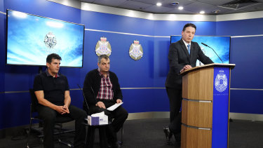 Vicki Ramadan's sons Edji Zenel (left) and Dennis Ramadan (centre) with Detective Inspector Tim Day.