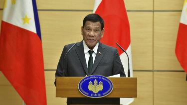 Philippine President Rodrigo Duterte delivers a speech in Tokyo.