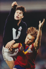 Golden fist: Danny Frawley in action against Tony Modra during a 1993 State of Origin contest.