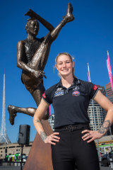 Tayla Harris unveils a prototype of her upcoming bronze statue.