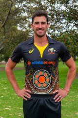 Mitchell Starc models Australia's Indigenous cricket uniform.