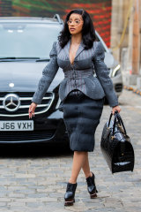 Rapper Cardi B toting a large bag at Paris Fashion Week.