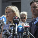 Virginia Roberts Giuffre, who says she was trafficked by sex offender Jeffrey Epstein, holds a news conference outside a Manhattan court with her lawyer, right, Brad Edwards in August last year.