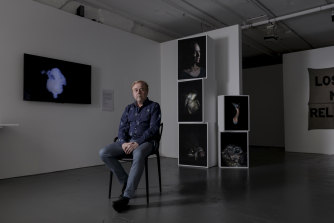 Australian Centre for Photography chief executive Pierre Arpin with photographs by Maija Tammi.