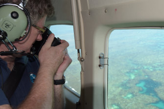 Professor Terry Hughes conducts a coral bleaching aerial survey at the reef.