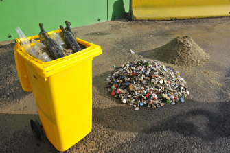 The Alex Fraser Group's recycling plants crush glass into sand used to make asphalt.