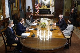 Prime Minister Scott Morrison, top right, also met with US Vice-President Kamala Harris and Japanese President Yoshihide Suga, second from left.